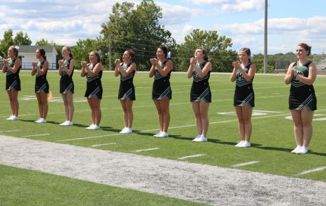 New coaches, cheerleaders work to build a strong foundation