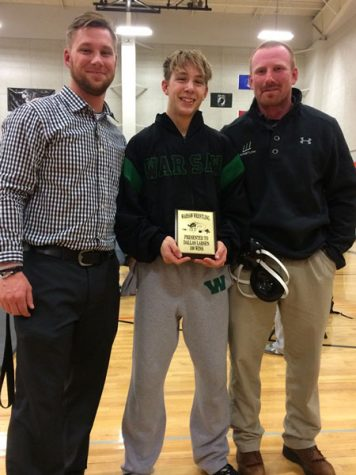 Wrestling team continues toward goals as junior gains 100th win