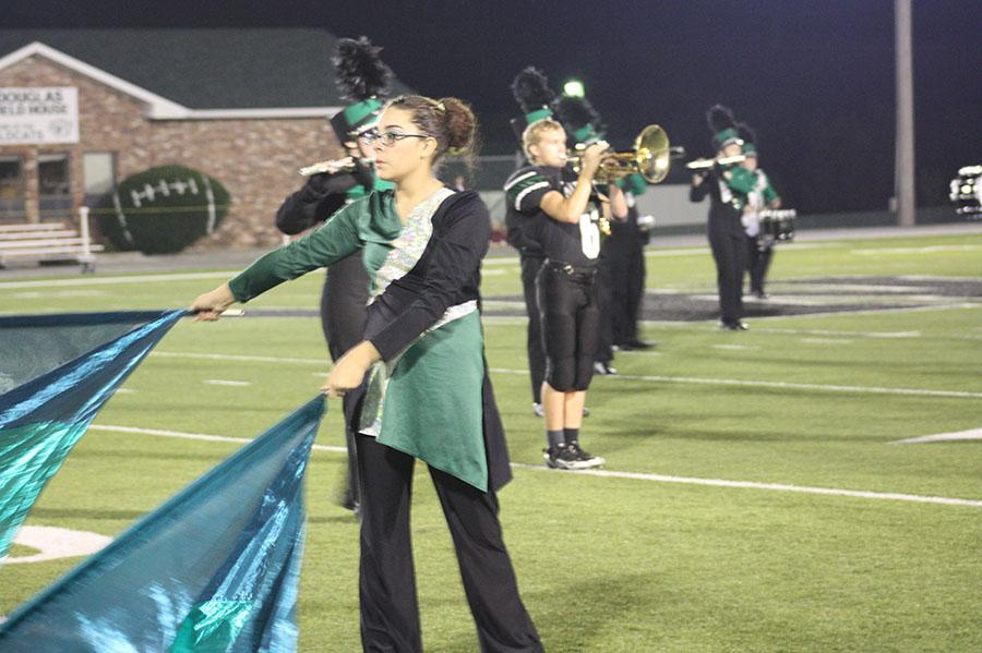 Senior+Amber+Gillham+performs+in+the+halftime+show+of+a+home+football+game.+The+theme+of+this+year%27s+marching+band+show+revolves+around+the+word+%22fly.%22