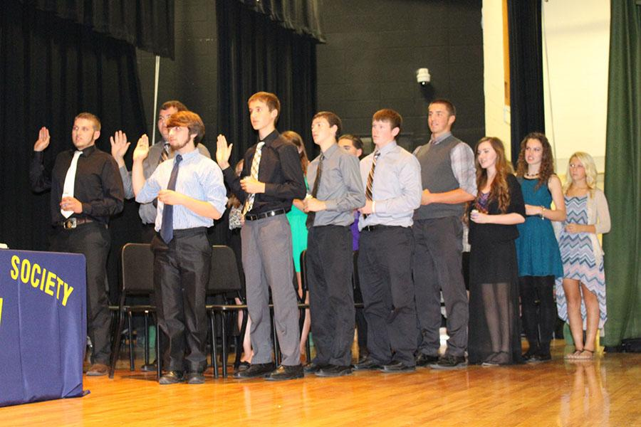 New+NHS+members+take+the+oath+during+the+induction+ceremony+on+Oct.+8.+Pictured+are%3A+senior+Austin+Yoder%2C+senior+Zach+Long%2C+junior+Michael+Kephart%2C+junior+Thane+Henderson%2C+senior+Tyler+Dority%2C+senior+Joey+Cooner%2C+and+juniors+Bridget+Clarke%2C+Rickie+Branson+and+Payton+Adair.