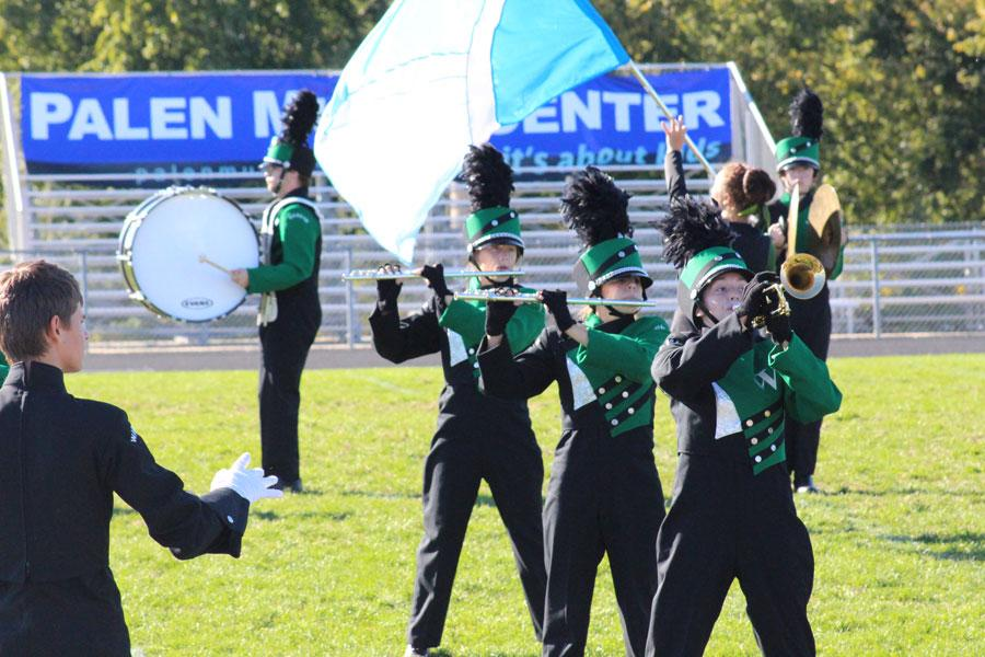Sophomore Tristin Surrell, freshman Kyra Kleihauer and junior Kylie McRoberts perform during the Odessa marching competition.