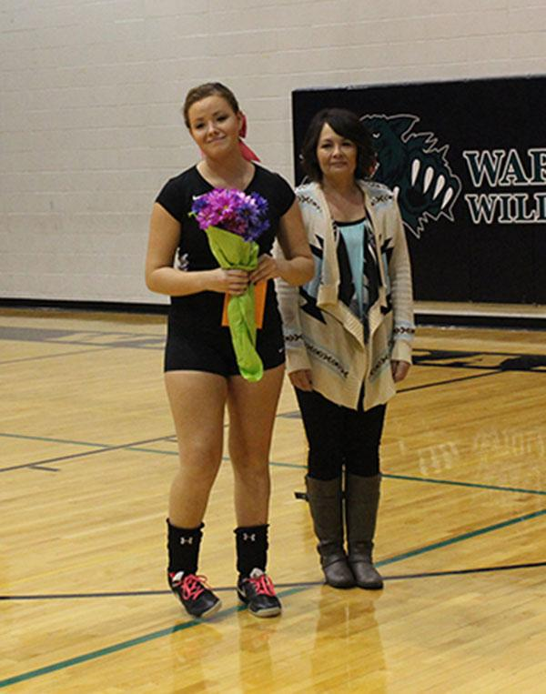 Senior Briar Collins and mother Dawn Nelson are recognized at the volleyball senior night. Collins was the only senior playing volleyball this year.