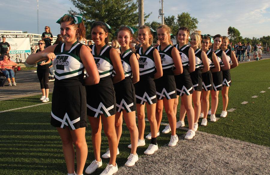 Cheerleaders line up for the national anthem at the first home football game of the season. They included senior Tristen Weiser, junior Clara McMurtry, junior Alexis Riga, junior Melissa Scrivener, sophomore Brennan Bell, sophomore Kalee Schietzelt,  and freshmen Cora Rogers, Emily Stantorf, Kylee Myers, and Briar Strunk..