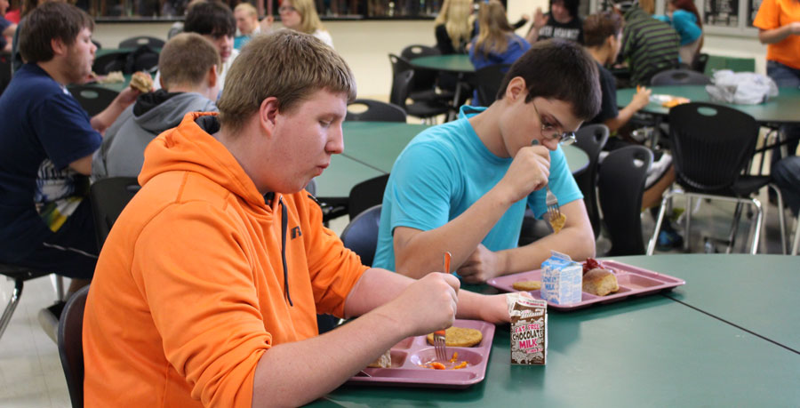 Juniors Justice Taylor and Timothy McClusky enjoy free meals during the school day.