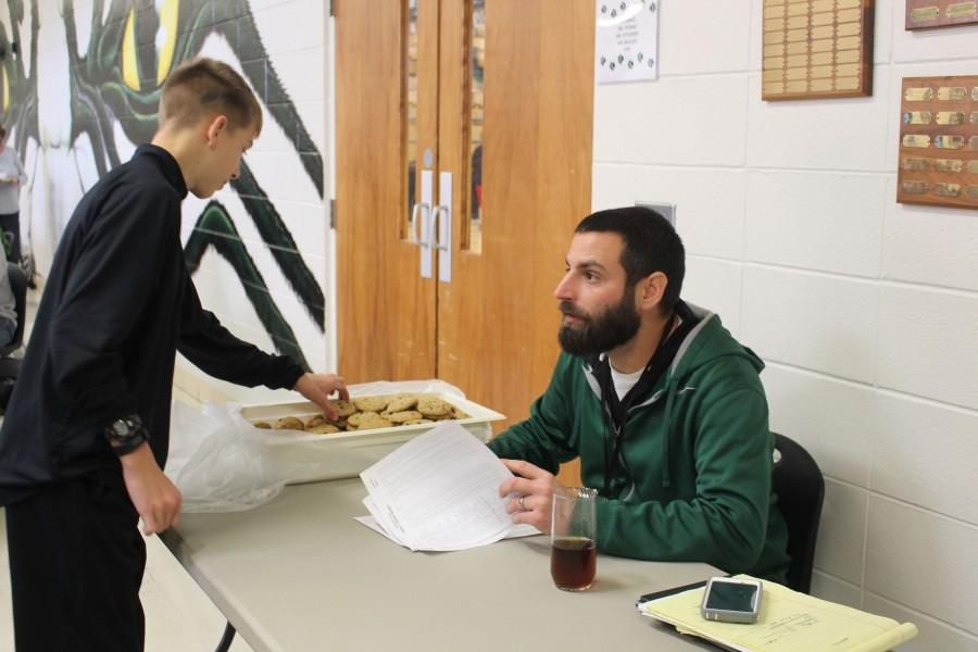 Mr Wallace hands out cookies for the students with perfect attendance.