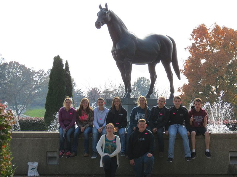 FFA members Alexis Smith, Tristen Surrell, Thane Henderson, Cierrra Sawyers, Ashlyn Yoder, Zach Swiger, Rayne Faulkoner, Noah Long, Jazmine Holbert and Seth Eckhoff pose for the camera. They where at the Kentucky Horse Park in Lexington.