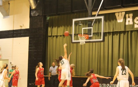 Junior Emilee Proctor goes to shoot during the game. The team played the Lincoln Cardinals.