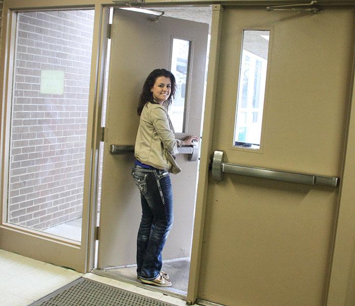 Senior Kylie Walker steps out of the front doors. Walker is planning on going to State Fair Community College.