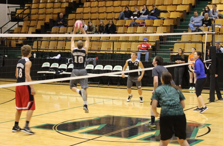Senior Randall Sherman sets the ball to senior Jeremy Eierman. The senior won the Volleyflip tournament.
