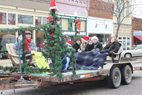 Members of the English Club rode on the float that they had decorated for the Christmas parade on Sat. Dec 6. The parade was held up town.