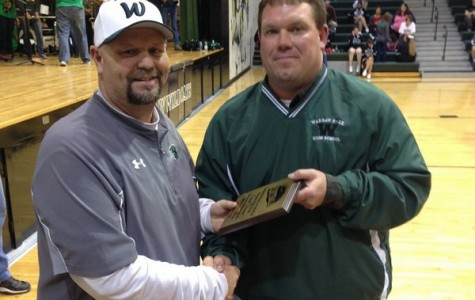 Coach Thomas receives Hall of Fame award.   Thomas has been a coach for thirty one years.