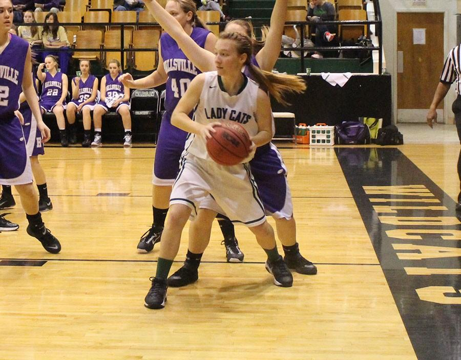 Senior post Jessica Kuykendall getting ready to pass the ball during their game against Hallsville.