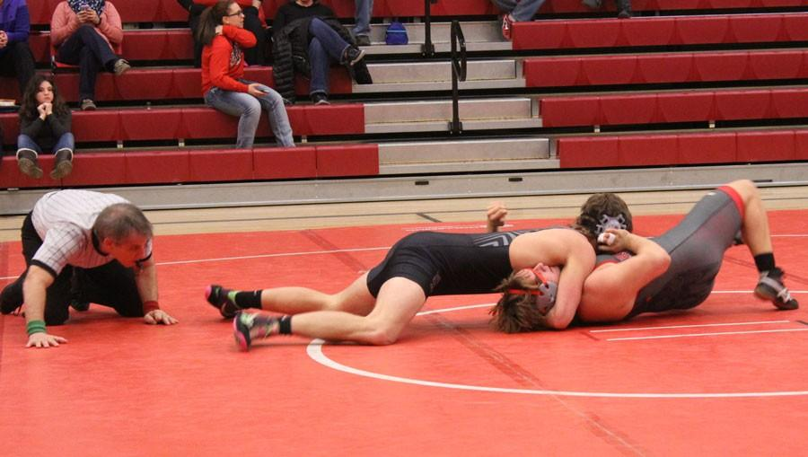 Senior Kyle Goodsell pins his opponent from Carrollton. Goodsell currently has 17 pins for this season.