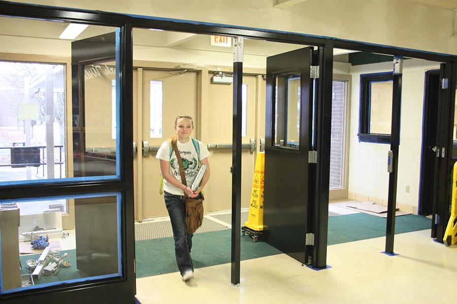 Junior Lydia Schockmann  enters the school through the new set of doors. The new doors cost $87,000 for all five sites.