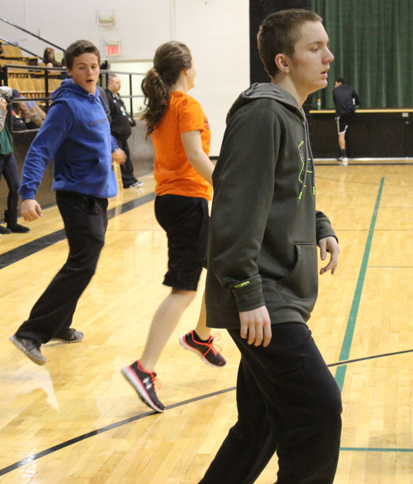 Juniors John Hargrave and Taylor Goetz along with sophomore Anthony Beuke get their exercise in during their physical education class. Most students get their exercise in during school.