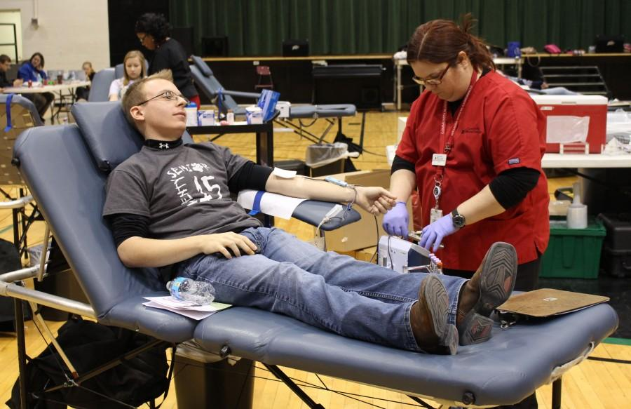 Senior Zach Swiger donates blood on Friday, March 6, 2015. This was his first time donating.