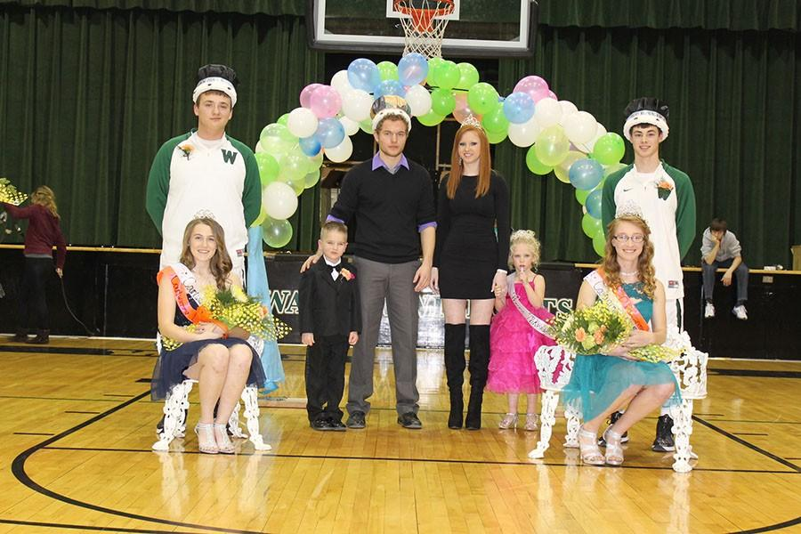 The Coutwarming royalty reign on the court. They include Princess junior Kylie McRoberts, Prince junior Austin McCall, Aiden Comer, 2014 king Paul Derks, 2014 Queen Erika Jones, Queen senior Jessica Kuykendall and King senior Lane England.