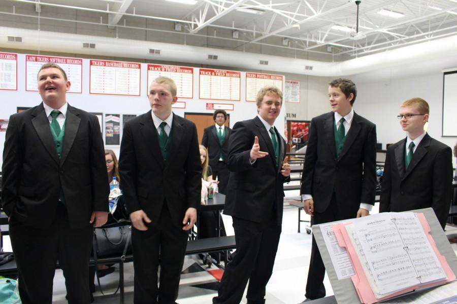 Sophomores Seth Eckhoff and Michael Pierce, senior Jordan Jonhson, junior Conner Wood, and sophomore Jonathan Petesch prepare themselves to compete in the District Small Ensemble Contest.