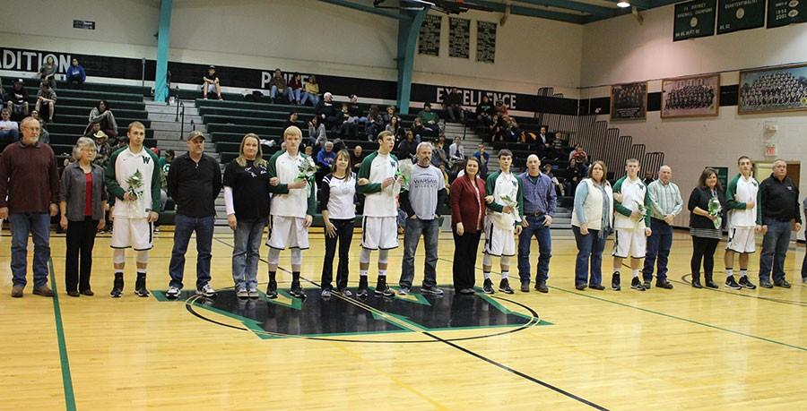 Senior+players+line+up+with+their+families+during+senior+night.+They+include+guard+Randall+Sherman%2C++forward+Tommy+Proctor%2C++guard%2Fforward+Bailey+Jelinek%2C+guard+Lane+England%2C++point+guard+Tyler+Dority%2Cand+guard+Joey+Cooner.