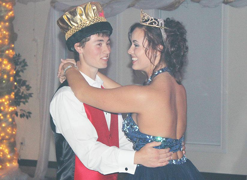 Prom+king+Alex+Letcher+dances+with+prom+queen+Briar+Collins.+Prom+was+held+April+11th.