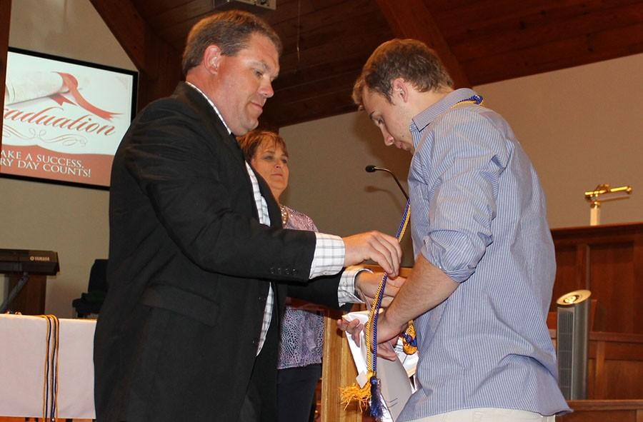 Senior+Randall+Sherman+receives+his+NHS+cord.+This+was+his+first+year+in+NHS.
