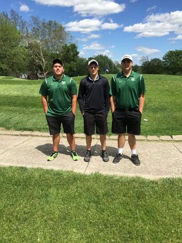 Junior Jamie Jimenez, seniors Even Engebretsen, and Luke Spry pose before competing at the District Golf Tournament.