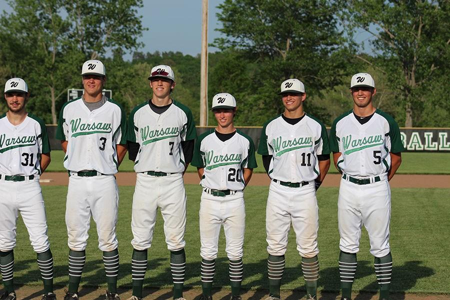 Seniors Kyle Goodsell, Bailey Jelinek, Alex Letcher, Jeremy Eierman, and Joey Cooner line up for a picture during senior night. The boys won against Osage 15-0.
