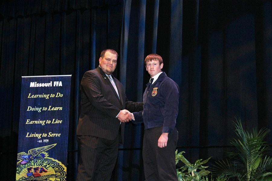 Senior+Tyler+Dority+receives+his+state+FFA+degree.+The+state+degree+is+the+second+highest+in+the+organization.