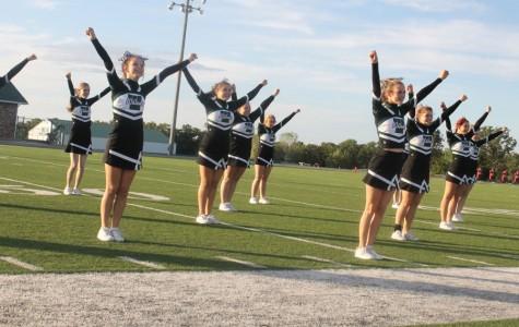Varsity Cheerleaders perform before homecoming game. They include, freshman Shelby Dunum, senior Alexis Riga, freshman Chloe Lux, junior Johna Newman, freshman Trinidy Brownfield, senior Melissa Scrivener, sophomore Emily Stantorf, freshman Kayla Boucher, and sophomore Cora Rodgers.