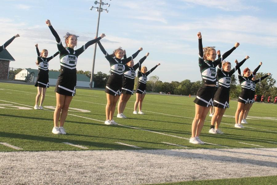 Varsity Cheerleaders perform before homecoming game. They include, freshman Shelby Dunum, senior Alexis Riga, freshman Chloe Lux, junior Johna Newman, freshman Trinidy Brownfield, senior Melissa Scrivener, sophomore Emily Stantorf, freshman Kayla Boucher, and sophomore Cora Rodgers.