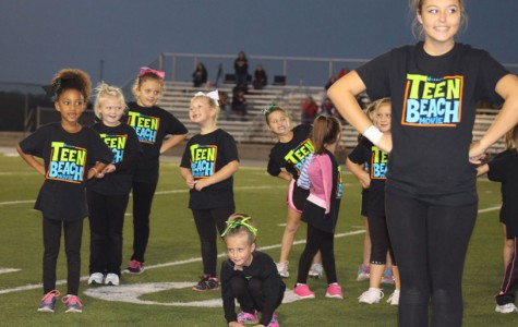 Freshman Chloe Lux leads girls in a cheer dance on October 5, 2015 during halftime of a JV football game.