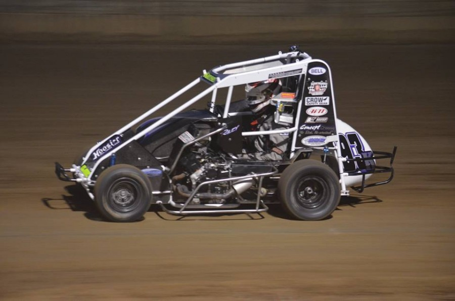 Riley Kreisel races another one of his cars on a dirt track, all of his cars are made for dirt tracks.