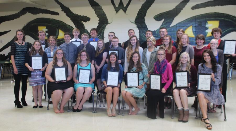 Warsaw NHS gathers after the induction ceremony. They include, (front row) Maddie Freeman, Samantha Thompson, Erica Flores, Bailey Sharp, Melissa Scrivener, Makayla Mais, Madison Grobe; (middle row) Alexis Smith, Ashlyn Yoder, Thane Henderson, Garrett Smith, Lydia Shockman, Jonathan Petech, Bridget Clark, Payton Adair, Kylie McRoberts, Maddy McMillin, Mary Porter, Cheyenne Duffy;  (back row) Rickie Branson, Nathan Townley, Chance Adams, Blake Broderson, Andrew Savage, Cade Chiles, Michael Kephart, Austin McCall, Claudia Schmitz, and Noah Long. Photo by Kyra Kleihauer.