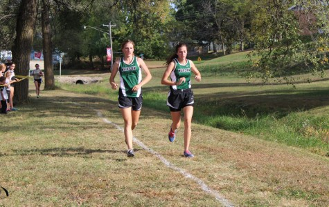 Sophomore Mikayla Andrews and junior Bailey Sharp run their course at the Stover meet.