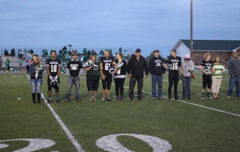Seniors stand with their parents as they get introduced for their last home game of their high school career. Starting from the left: Seniors Devon Parish, Bob Hensley, Terrence Conness, and Andrew Bozarth.