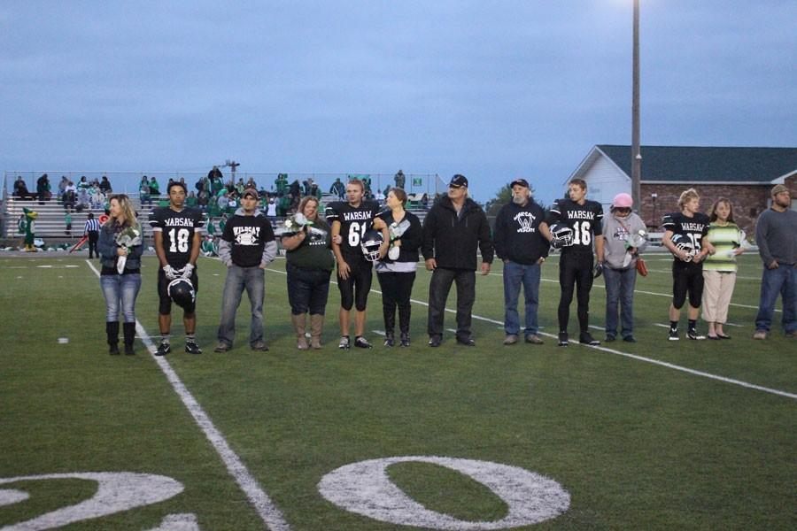 Seniors+stand+with+their+parents+as+they+get+introduced+for+their+last+home+game+of+their+high+school+career.+Starting+from+the+left%3A+Seniors+Devon+Parish%2C+Bob+Hensley%2C+Terrence+Conness%2C+and+Andrew+Bozarth.