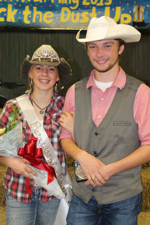 Juniors Ashlyn Yoder and Hunter Bagley celebrate after being crowned Queen and King of Barnwarming. There were three steps to the voting process: penny wars, a ballot vote, and interview.
