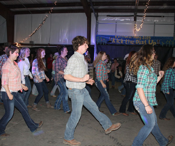 Senior+Stephanie+Fisher%2C+junior+Noah+Long+and+junior+Samantha+Thompson+line+dance+to+%E2%80%9CCopperhead+Road.%E2%80%9D+Middle+School+counselor+Katie+Johnson+held+free+line+dancing+lessons+for+the+whole+student+body+in+preparation+for+the+dance.