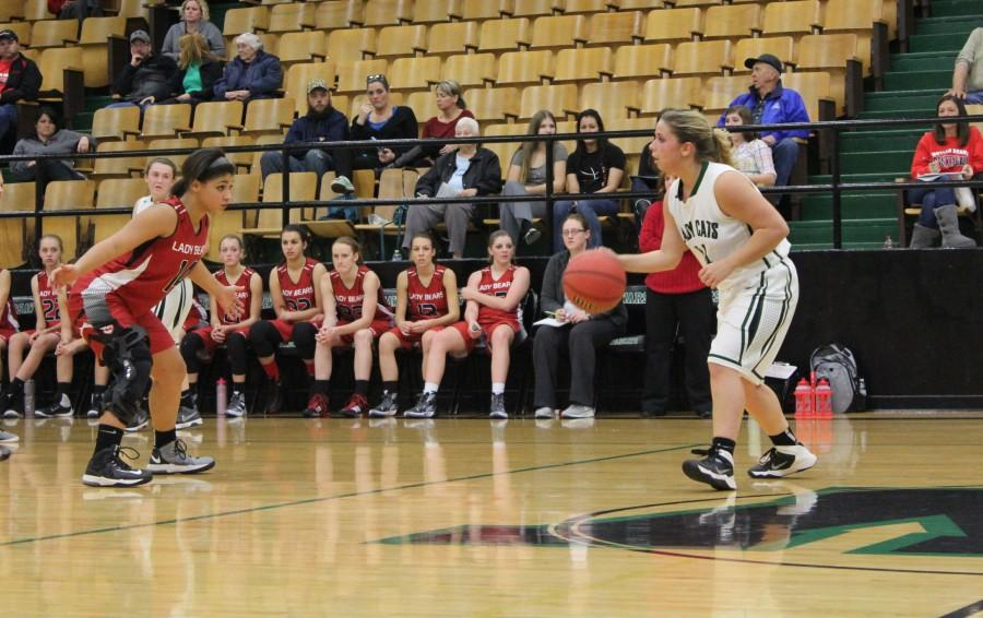 Senior+guard+Raven+Caswell++dribbles+the+ball+as+she+plans+out+the+next+play+during+their+game+against+Butler.+The+girls+lost+72-42.+