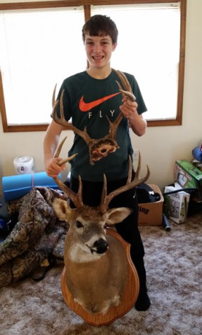 Sophomore Ryan Sprouse is holding the bucks he shot last year (bottom) and this year (top). Both deer are ten point bucks. -Photo Submitted