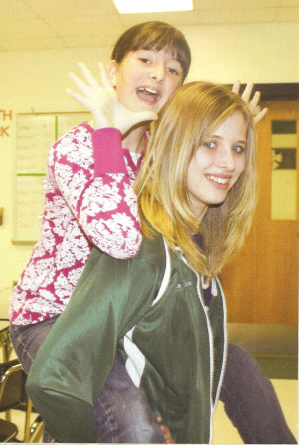 Erica Flores and Shyla Estes have a fun piggyback ride. The two had fun in yearbook club!