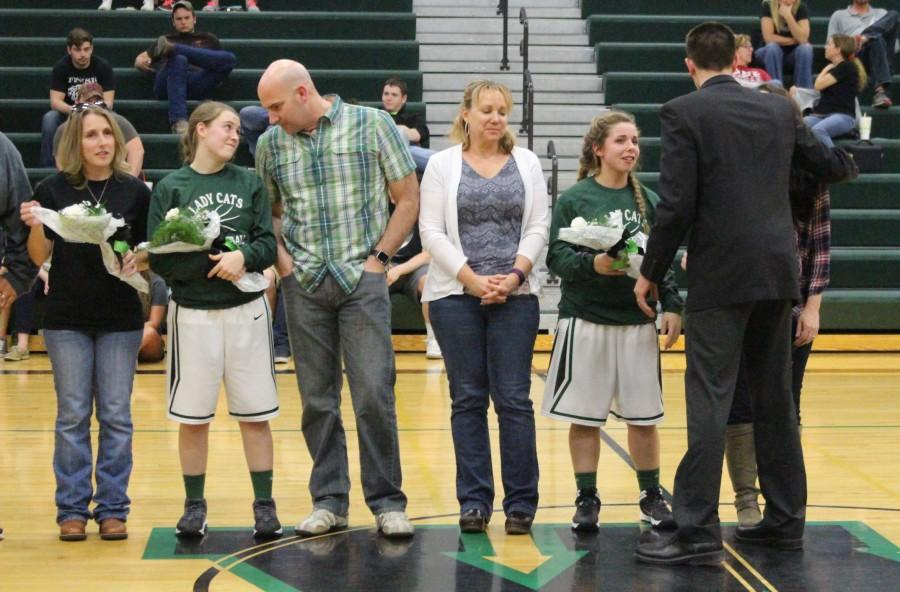 Seniors+Kylie+McRoberts+and+Raven+Caswell+celebrate+senior+night+with+their+families+after+the+Southern+Boone+game.+Senior+night+was+held+on+February+19.+