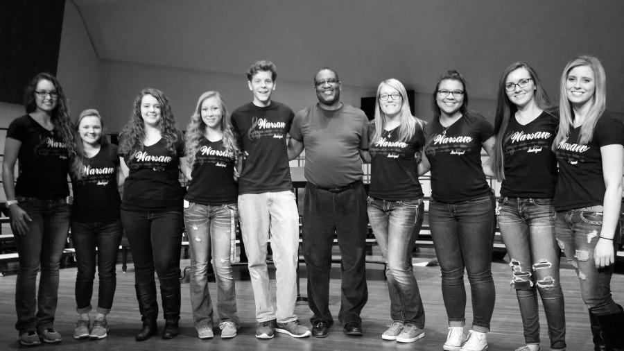Seniors Rickie Branson, Lydia Shockman, Haylee Pals, Madeline McMillin , clinician director  Bernard Brown, seniors Madison Lane, Keyona Davis, Bridget Clarke, and Shyla Estes stand together. These seniors are in Madrigal and performed at the Tri County vocal Clinic.