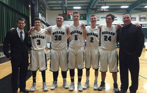 Assistant coach Derald Henderson, seniors Thane Henderson, Austin McCall, Kyle Nevius, Johnathan Plybon, and Damian Adams, and head coach Jason Ollison line up for  photo. Senior night was February 19.