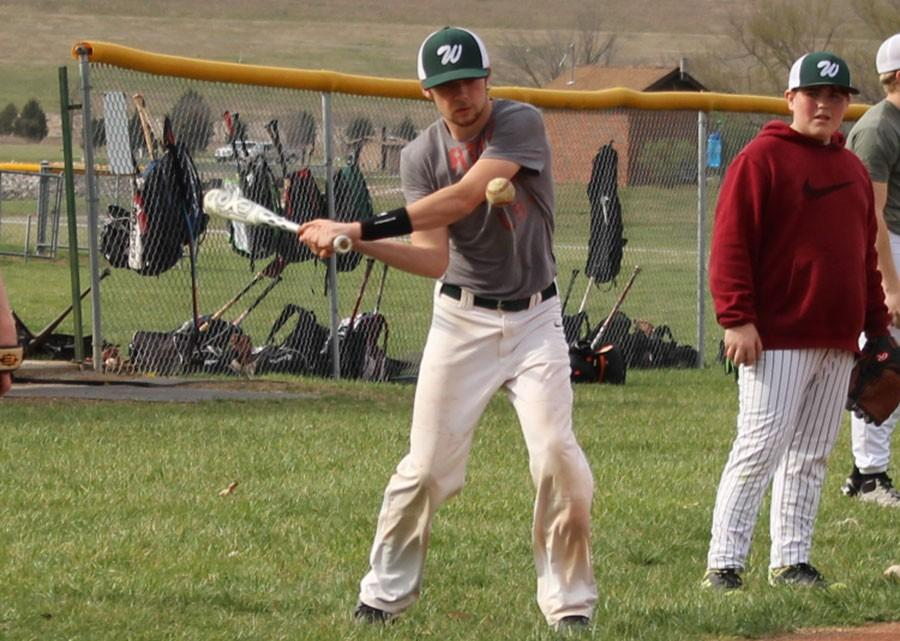 Junior Hunter Bagley hits baseballs to teammates to practice fielding. Bagley is one of five experienced players to return to the team.
