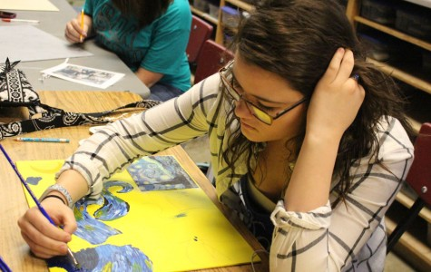 "Junior Rebecca Letcher works on a painting of ""Starry Night."" She has been in an art class since freshman year."