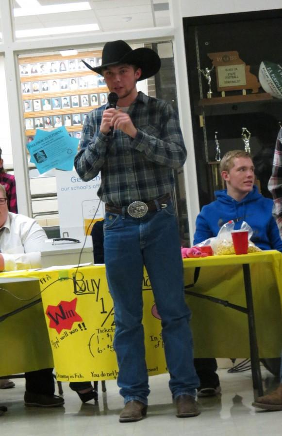 Junior Hunter Bagley looks for bidders at the FFA worker's auction. For Bagley's special talent, he was the auctioneer, auctioning off his fellow FFA members.