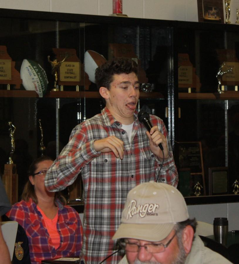 Senior Thane Henderson performs stand-up comedy for his special talent. The worker's auction was held for the FFA members their family and friends to bid on the students for a day of work.
