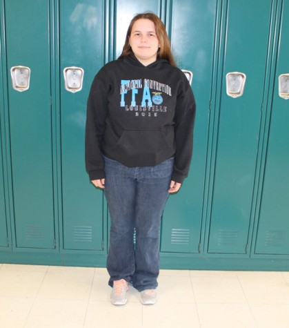 Junior Alexis Smith stands in front of the lockers in the school she knows so well.  Smith is this months high school hero.