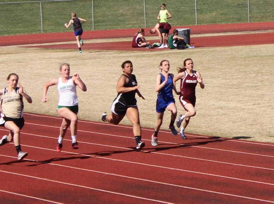 Senior Keyona Davis runs in the 100 meter dash at Eldon's track meet.  Davis runs the 100 meter dash every track meet.